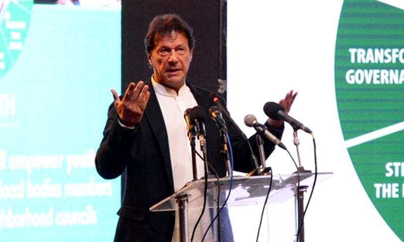 Prime Minister Imran Khan speaks at an event upon completion of KP government's 100 days in office on Friday. — Photo courtesy: Radio Pakistan