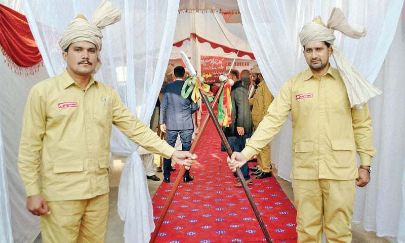 GPO staff in traditional clothes stand outside the venue of the ceremony on Friday. – Online
