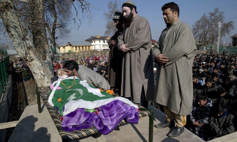 Kashmiri villagers offer prayers near the body of Murtaza, a 14-year-old civilian, in Pulwama, south of Srinagar. —AP