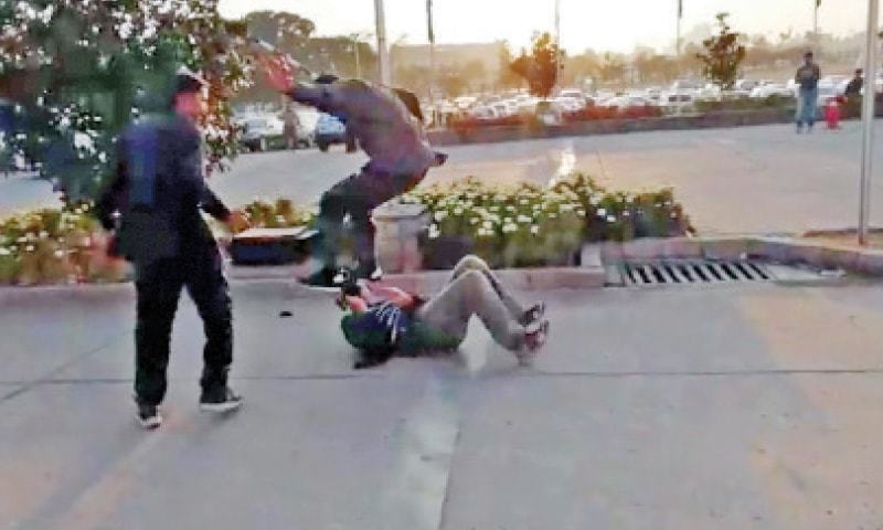 A video grab shows Nawaz Sharif's security guard assaulting the cameraman outside the Parliament House on Monday.