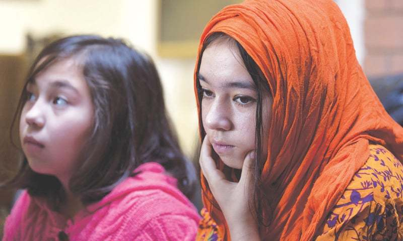 IN this Nov 29, 2018, photo, Shahnaz, 16 (right) and Shakeela, 12, daughters of Mir Aman, speak to The Associated Press.—AP