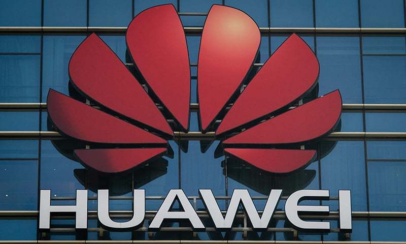 The Huawei logo stands on a Huawei office building in Dongguan in China's southern Guangdong province on December 18, 2018. — AFP