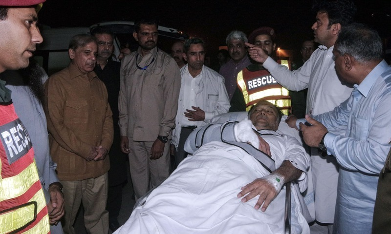 Shahbaz Sharif looks on as Ahsan Iqbal is evacuated via helicopter after reaching Lahore. — PID