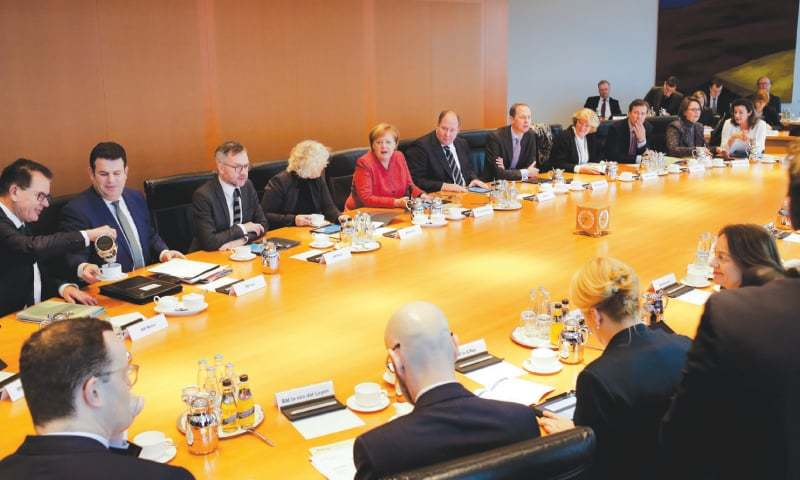 Berlin: German Chancellor Angela Merkel (centre left) and her cabinet discuss an initiative to attract foreign skilled workers.—AP