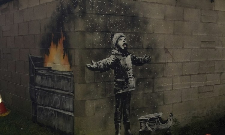 The street artist has left some new art up on a garage in Port Talbot referencing the town's air pollution
