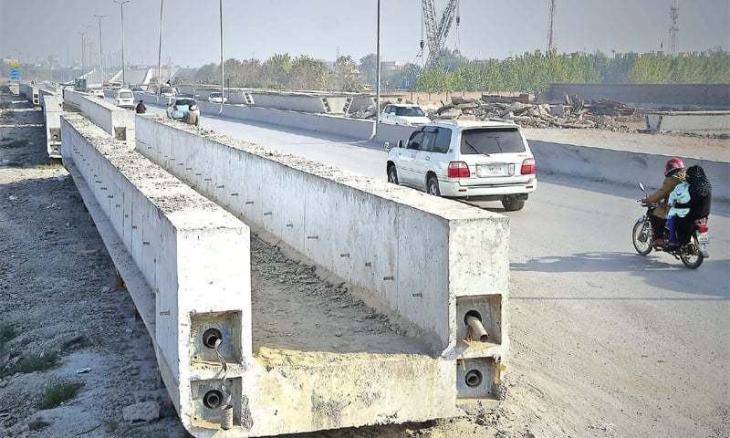 Traffic wardens are affected by dust storms caused by the heavy construction activity over the past year. — File photo