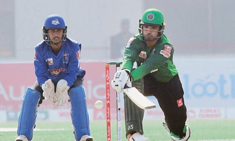MULTAN: Islamabad's hero Asif Ali attempts an unorthodox shot during his blistering 62-ball knock of 97 as Karachi Whites wicket-keeper Mohammad Hasan looks on during the National T20 Cup fixture at the Multan Cricket Stadium on Friday.—APP