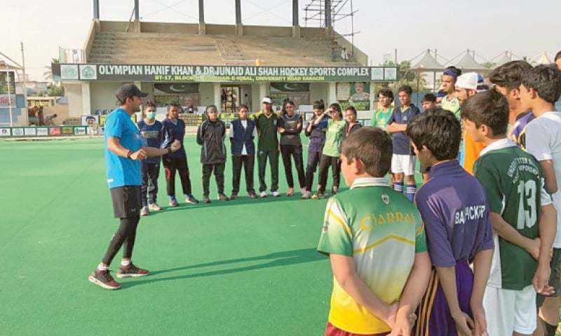 FIH coach Adnan Zakir tells basics of the game to boys and girls at the KHA Stadium.