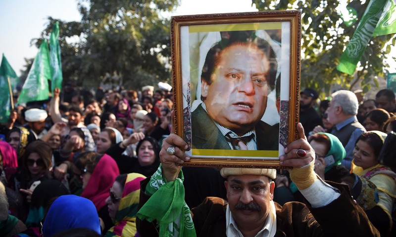 Supporters of former prime minister Nawaz Sharif gather outside the anti-corruption court in Islamabad on Monday, ahead of the court verdict against Nawaz in the Al-Azizia and Flagship Investment cases. — AFP