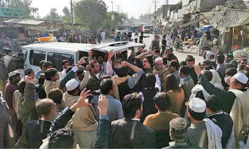 Killing sparks protests by lawyers who placed his body at the busy Kashmir Chowk. — Dawn