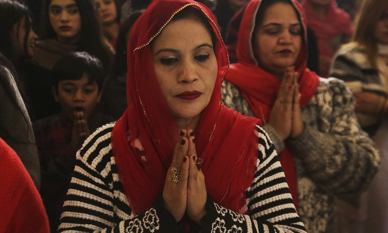 Christians attend midnight services at St. Anthony's Church to celebrate Christmas in Lahore, Pakistan, ─ AP