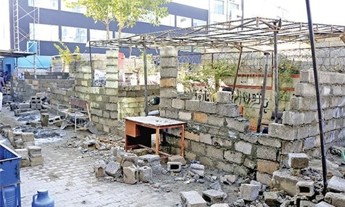 File photo shows demolished chambers of lawyers in F-9 Markaz.