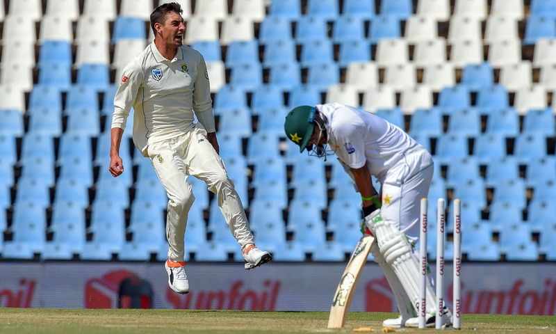 Duanne Olivier celebrates as he bowls out Imamul Haq for 57 runs during day two of the cricket test. —AFP