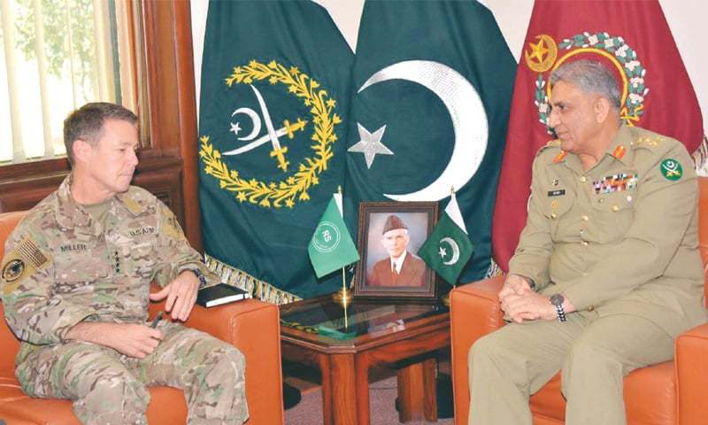 CHIEF of the Army Staff Gen Qamar Javed Bajwa speaks to commander of the Resolute Support Mission in Afghanistan Gen Austin Scott Miller at the General Headquarters on Thursday.—PPI