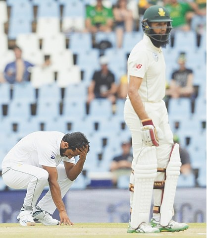 CENTURION: Pakistan fast bowler Hasan Ali reacts after Fakhar Zaman dropped a catch off South African batsman Hashim Amla during the first Test at the SuperSport Park on Friday.—AP
