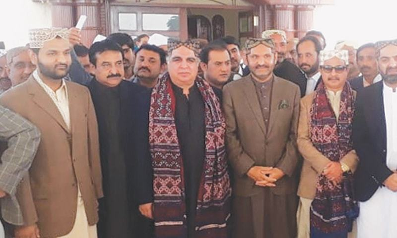 Governor Ismail and PTI leaders emerge from Mahars' residence after holding a session on Sunday.—Dawn