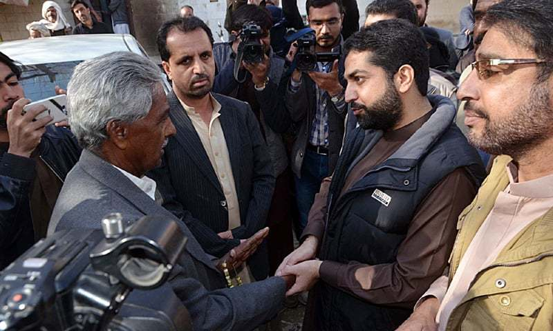 QUETTA: Balochistan Home Minister Mir Zia Langove shakes hands with Voice for Baloch Missing Persons vice chairman