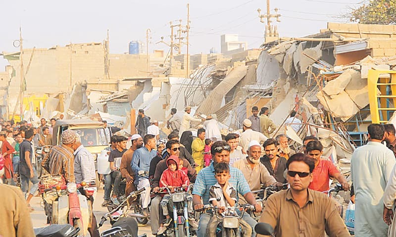 AN anti-encroachment operation in progress  in a Korangi locality on Wednesday. — PPI