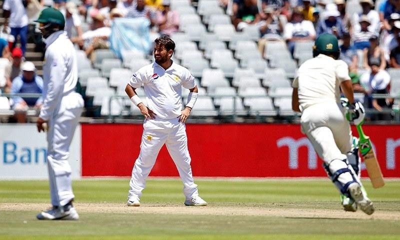 Yasir Shah looks on as South African batsmen run between the wickets. — AFP