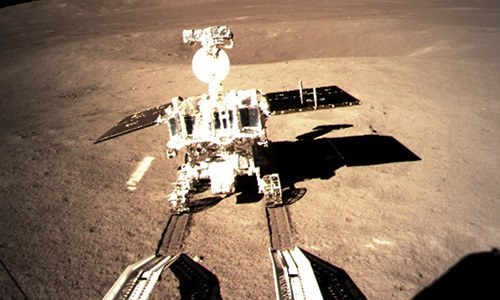 Yutu-2 China's lunar rover leaves wheel marks after leaving the lander that touched down on the surface of the far side of the moon. — AP