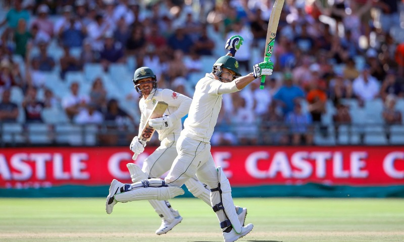 Faf du Plessis raises his bat after scoring a century during the second day of Test match. —AFP