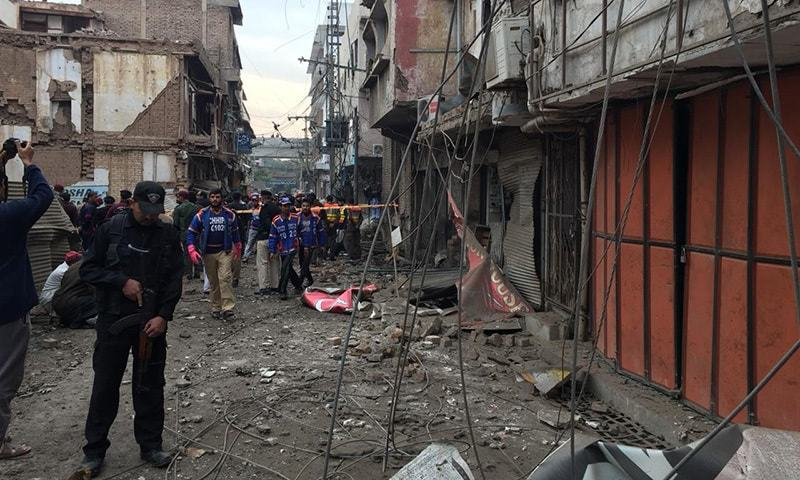 Security officials cordon off the site of the blast. — Photo by author