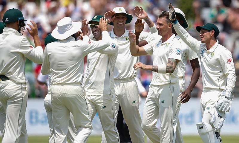 South African bowler Dale Steyn (2R) celebrates with teammates after the dismissal of unseen Pakistan batsman Imamul Haq. —AFP