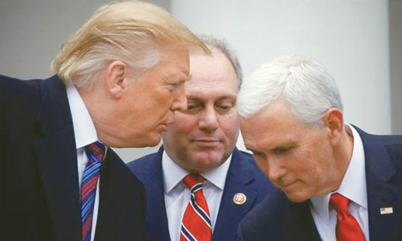 President Donald Trump confers with Vice President Mike Pence and House Minority Whip Steve Scalise as they faced to reporters in the Rose Garden after the president met with US Congressional leaders about the government shutdown and border security at the White House in Washington DC on Jan 4. President Trump and senior Democrats failed to strike a deal in talks on Friday to end a partial shutdown of the US government as they again fought over the president's request for over $5bn to fund his signature wall on the Mexican border.—Reuters