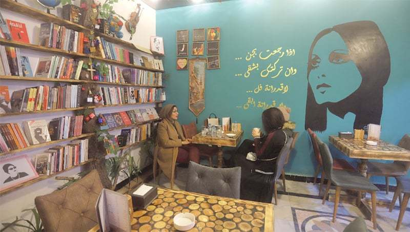 Basra (Iraq): Women drinking hot beverages at Fairouz Cafe and Bookshop, named after the famous Lebanese  singer Fairuz.—Reuters