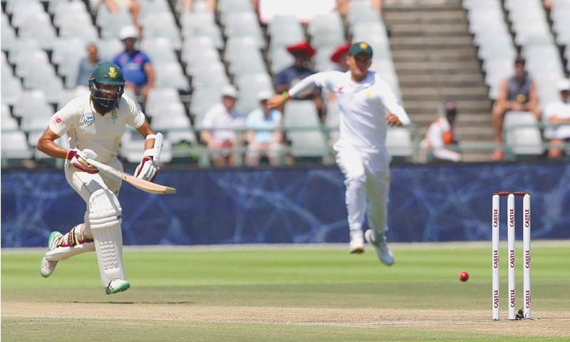 CAPE TOWN: South African batsman Hashim Amla sprints to avoid being run out in the second Test against Pakistan at Newlands on Sunday.—AP
