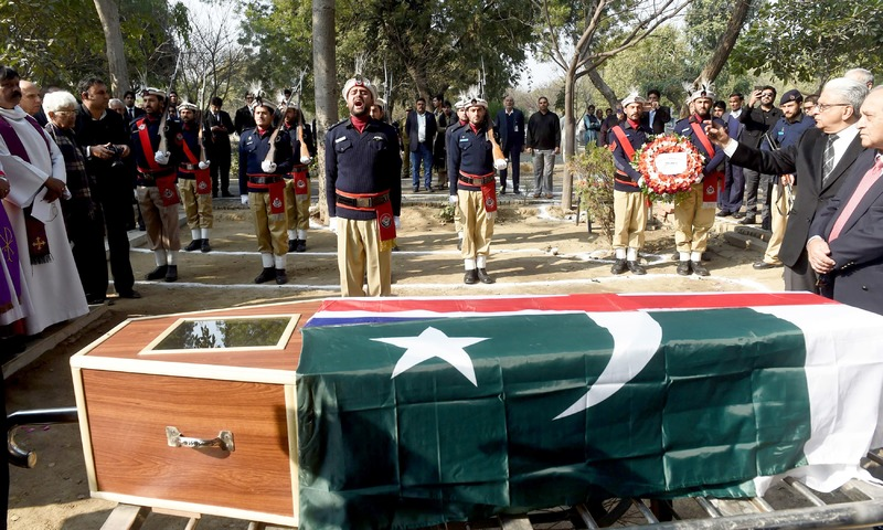 Chitral region policemen pay tribute beside the coffin of former British officer and teacher Geoffrey Douglas at his funeral in Lahore. —AFP