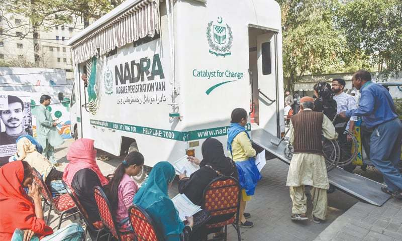 A SPECIAL person is helped into a Nadra van to have her CNIC made on Monday.—Fahim Siddiqi/White Star