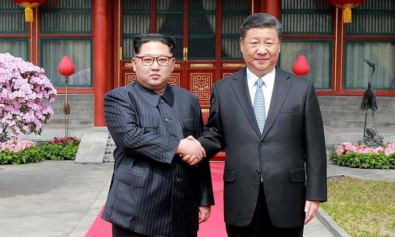 In this March 27, 2018, file photo, North Korean leader Kim Jong Un, left, shakes hands with Chinese counterpart Xi Jinping at Diaoyutai State Guesthouse in Beijing.    — AP