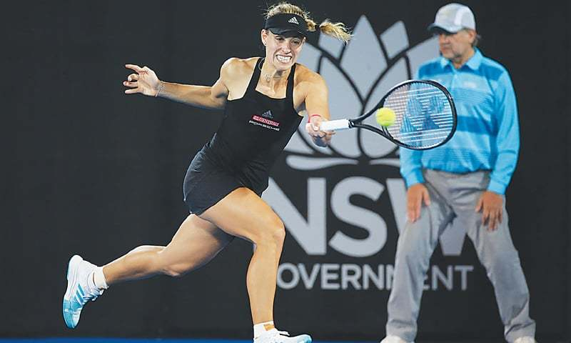 Angelique Kerber of Germany returns a shot to Italy's Camila Giorgi during their second-round match at the Sydney International on Tuesday.—AFP