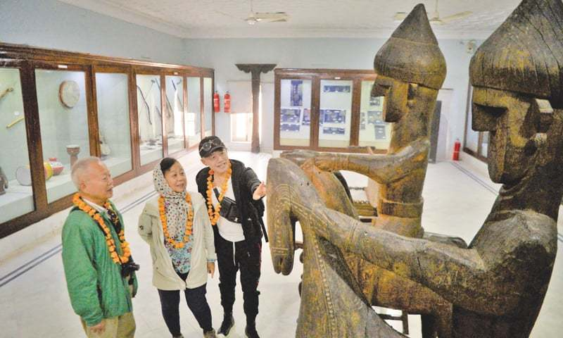 MEMBERS of the Chinese delegation take interest in artefacts during their visit to Peshawar Museum on