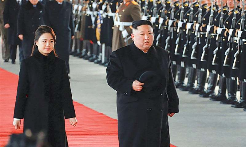 THIS picture taken on Monday and released on Tuesday shows North Korean leader Kim Jong Un and his wife Ri Sol Ju leaving Pyongyang Station to visit China.—AFP