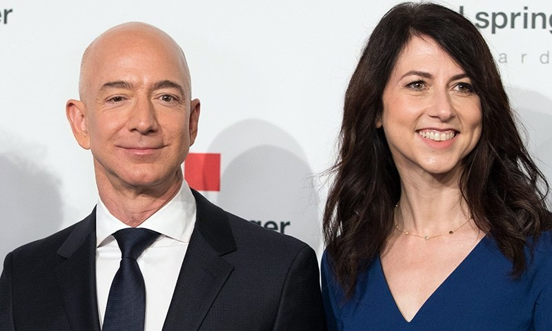 In this file photo taken on April 24, 2018 Amazon CEO Jeff Bezos and his wife MacKenzie Bezos  pose as they arrive at the headquarters of publisher Axel-Springer in Berlin. — AFP