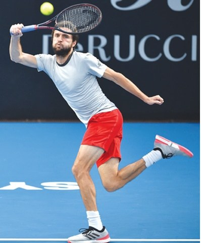 SYDNEY: France's Gilles Simon returns to Sam Querrey of the US during their second-round match at the Sydney International on Wednesday.—AFP