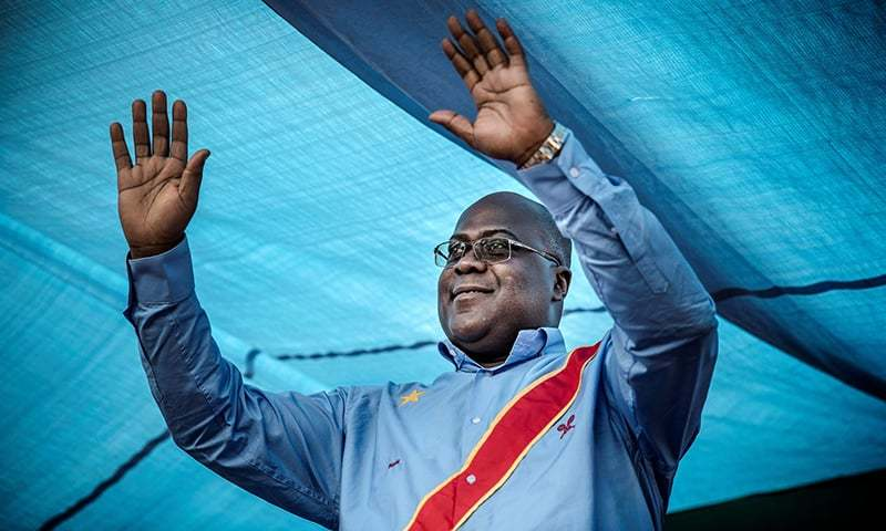 In this file photo taken on December 21, 2018 Democratic Republic of Congo's Union for Democracy and Social Progress  party leader and presidential candidate Felix Tshisekedi waves to the crowd during a campaign rally in Kinshasa, in the courtyard of the party's headquarter. — AFP