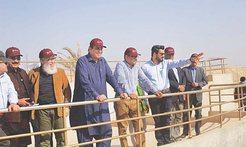 PM's Special Assistant on Power Shahzad Qasim and Sindh Energy Minister Imtiaz Shaikh along with SECMC executives visit a site at Thar Coal project's block-II on Thursday.—Dawn
