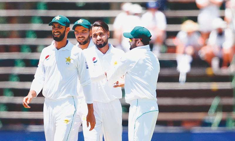 PAKISTAN pacer Faheem Ashraf (second R) celebrates with team-mates after dismissing South African opener Aiden Markram  on Friday.—AFP