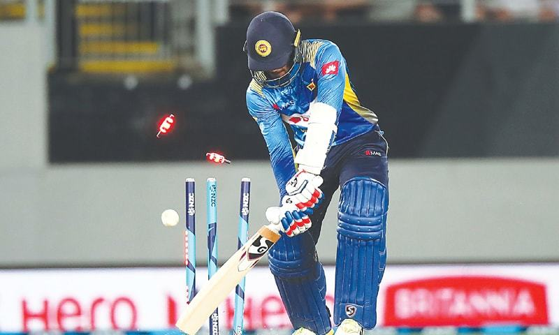 SRI LANKAN batsman Dhananjaya de Silva is cleaned up by  New Zealand fast bowler Lockie Ferguson during their one-off Twenty20 International at Eden Park on Friday.—AFP
