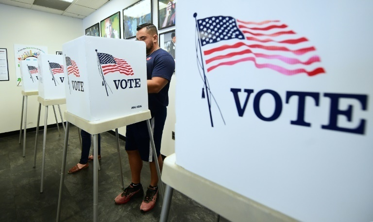 A file photo of a man casting his vote in the US.