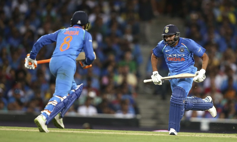 India's Rohit Sharma, right, and teammate Ravindra Jadeja make runs against Australia. —AP