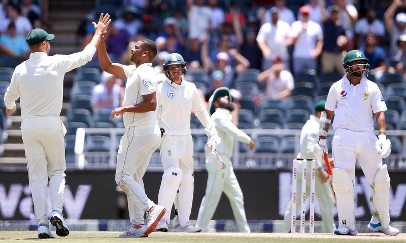 Vernon Philander celebrates with teammates the dismissal of Imamul Haq during the second day of the third Test. —AFP