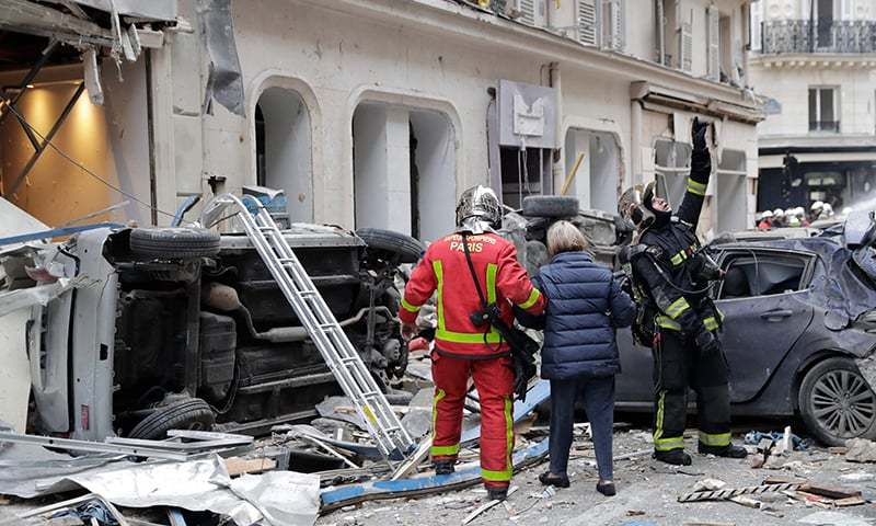 Cars were overturned by the blast and glass and rubble was strewn across large swathes of the street. —AFP
