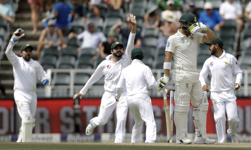South Africa's batsman Dean Elgar reacts as Pakistan players celebrates his wicket. —AP