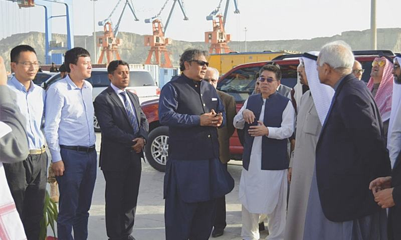MINISTER for Marine Affairs Ali Zaidi and Minister for Petroleum Ghulam Sarwar Khan talking to members of the Saudi delegation in Gwadar on Saturday.—Dawn