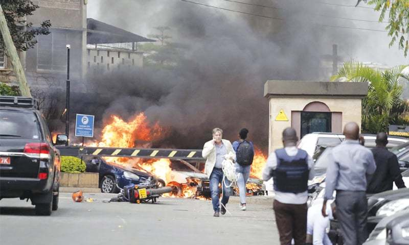 NAIROBI: Fire and smoke rise from the scene of the explosion.—AP