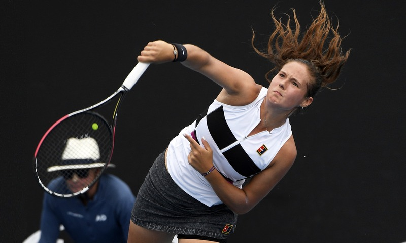 Russia's Daria Kasatkina serves to Timea Bacsinszky of Switzerland during their first-round match at the Australian Open on Tuesday.—AP